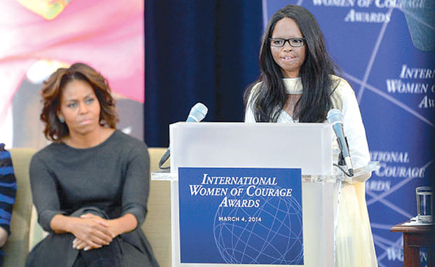 Laxmi Agarwal with First Lady Michelle Obama to receive International Women of Courage Award.
